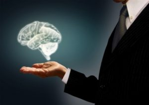 businessman-holding-a-virtual-brain-in-the-palm-skills-concept